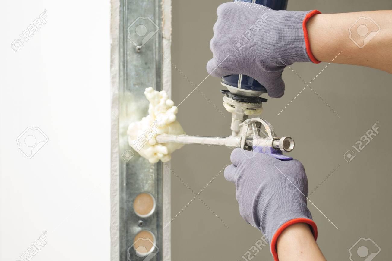 Installing Door Unit. Workman Fixing The Door Frame Using A Mounting ...