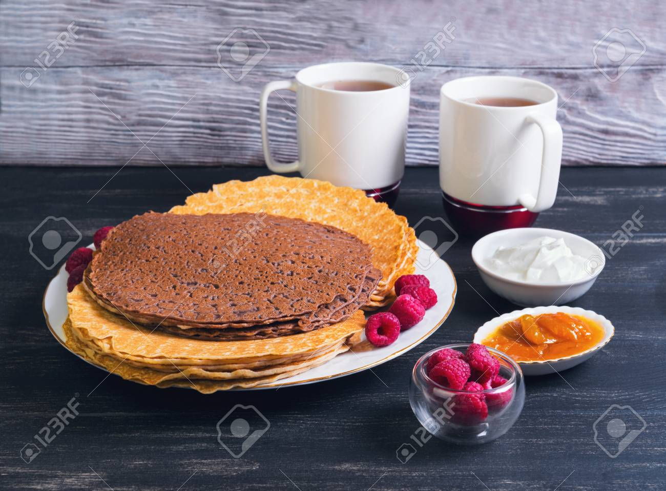 On A Black Background A Wooden Platter With Chocolate Pancakes Stock Photo Picture And Royalty Free Image Image 53579760
