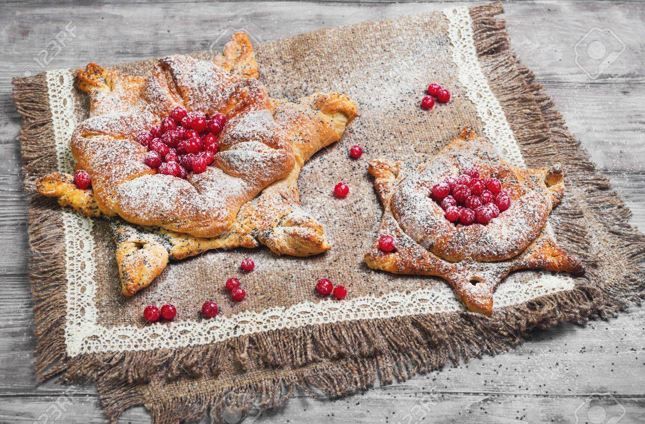 Sweet pastry buns danish in form of christmas snowflakes powdered stock photo sweet pastry buns danish in form of christmas snowflakes powdered sugar light white wooden background concept snow for christmas cards m4hsunfo