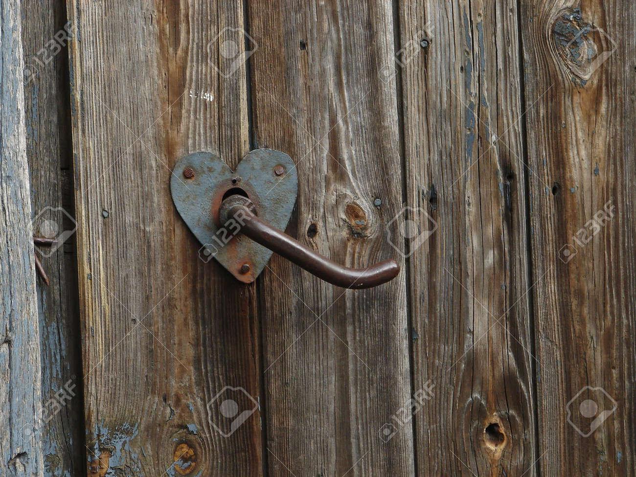 Aged door handle on wooden door Stock Photo - 731386