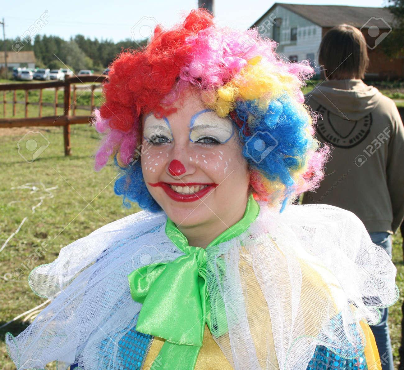 expressive bizzare clown in colored wig upon blue sky stock photo 1781737 - Colored Wig