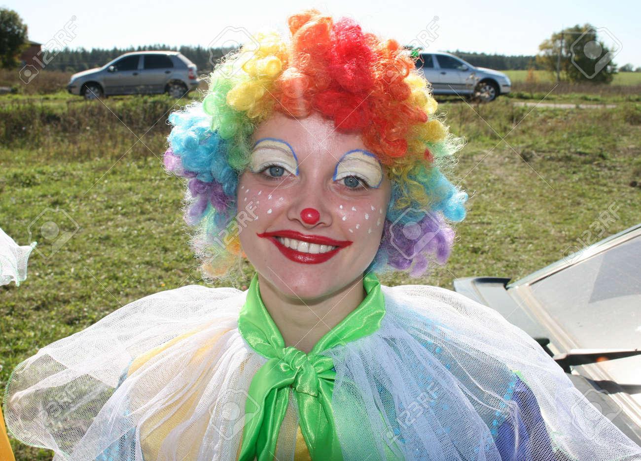 expressive bizzare clown in colored wig upon blue sky stock photo 1781742 - Colored Wig