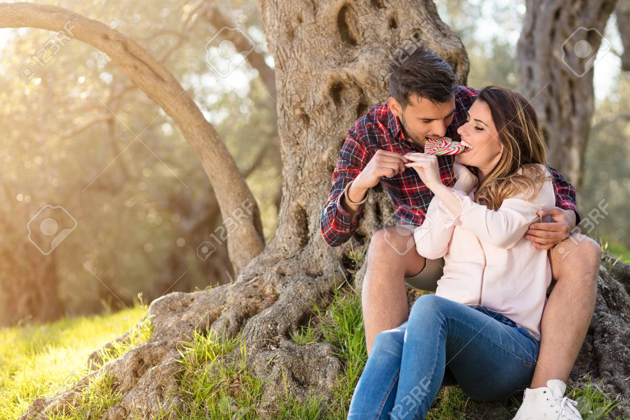 Stock photo young beautiful couple under tree in beautiful nature