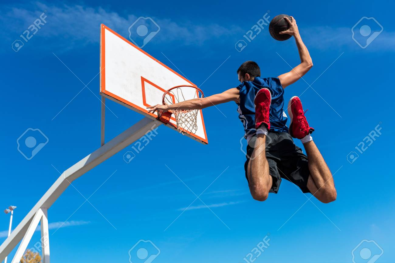 new arrivals 3dd5f fba3b Stock Photo - Young Basketball street player making slam dunk