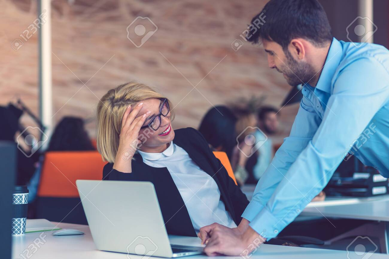 Happy business partners working on laptop. Teamwork, co-working concepts. - 133950046