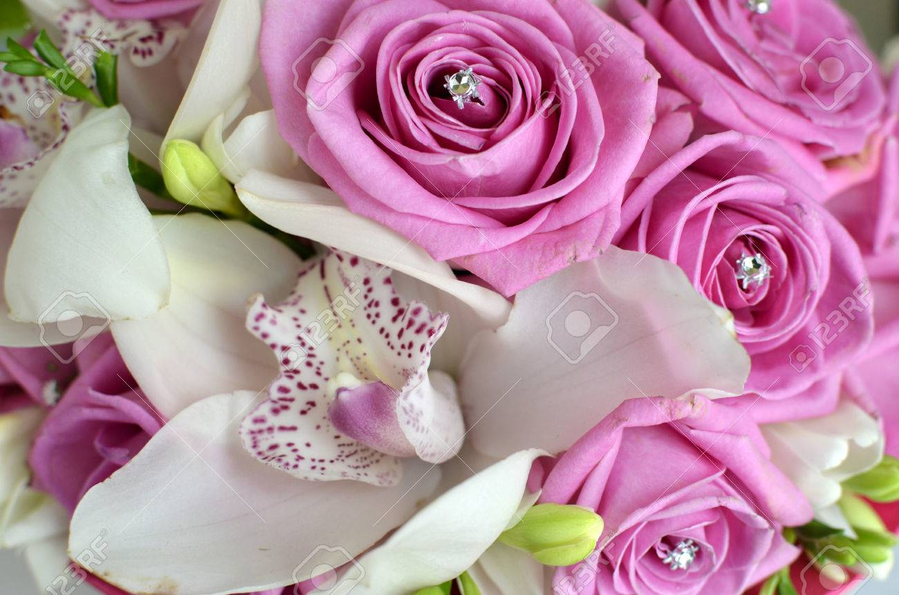wedding pink roses and white orchid bouquet stock photo
