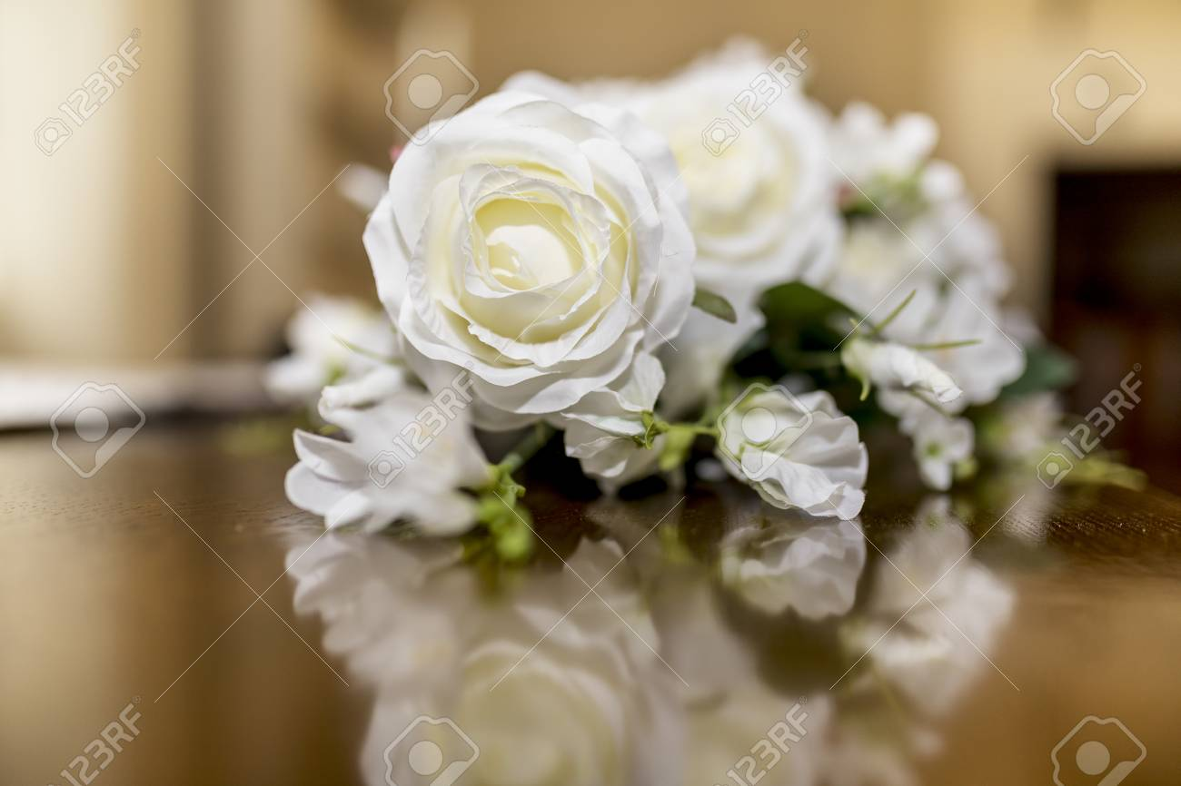 White Roses Wedding Bouquet Of Flowers Shot Close Up On A Wooden