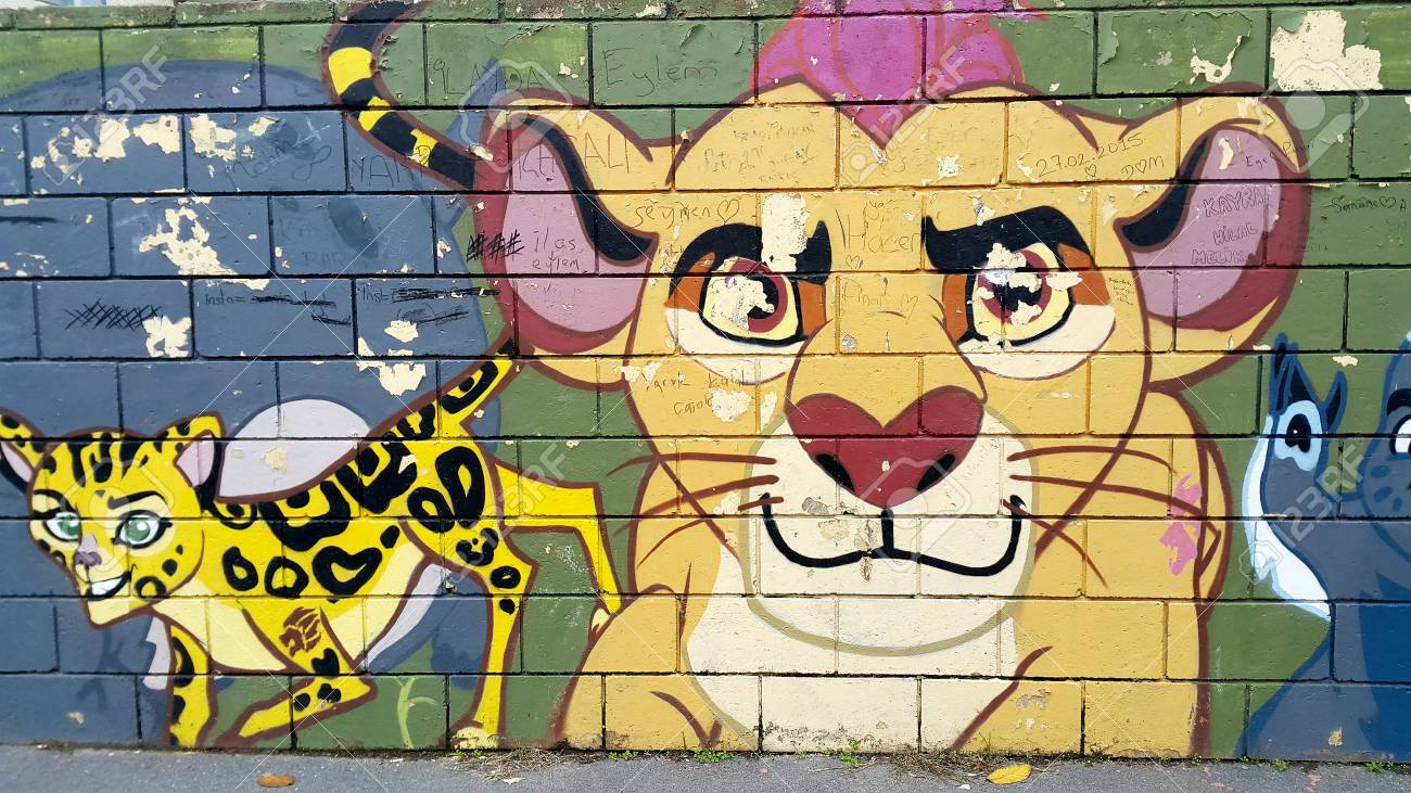 Beautiful Graffiti Wall In The Backstreets, With A Colourful.. Stock ...