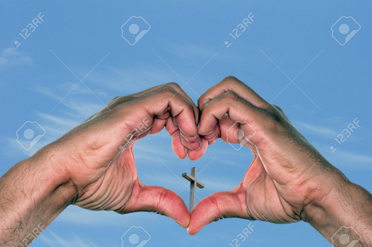 jesus is love concept with a pair of hands in a heart shape
