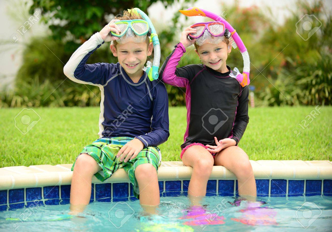 3c3cbe3e4e0 boy and girl children sitting on edge of pool ready for swimming Stock  Photo - 21383613