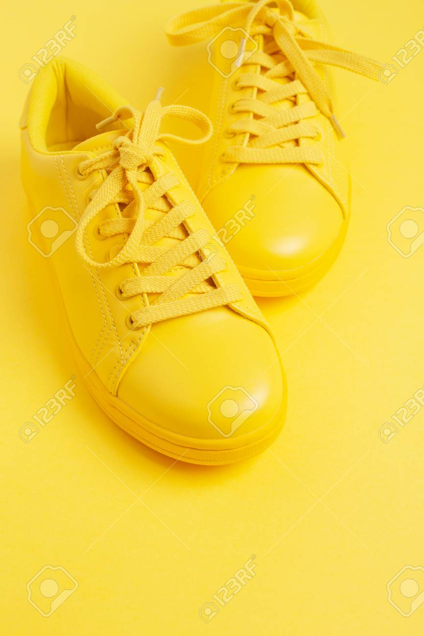 Pair Of Yellow Shoes On Yellow