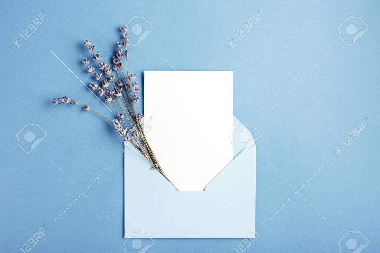 Mockup with card and lavender in blue envelope. Top view. - 108614604