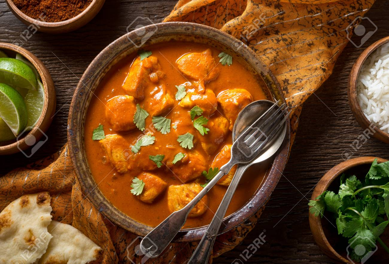 A Bowl Of Delicious Indian Butter Chicken Curry With Naan Bread Stock Photo Picture And Royalty Free Image Image 89926376