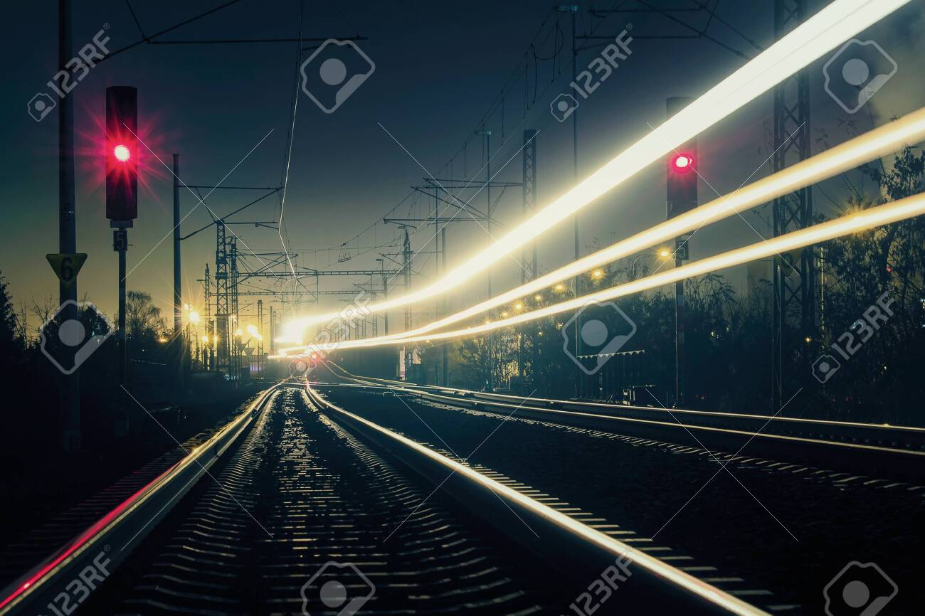 Train light trail with red light, long exposure - 123954340
