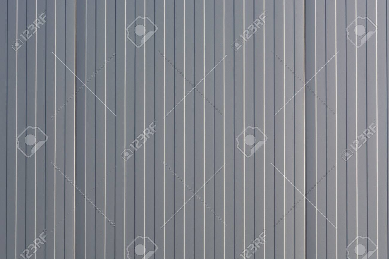 Silver-colored Metal Wall Corrugated Sheet Metal Background. Stock ...
