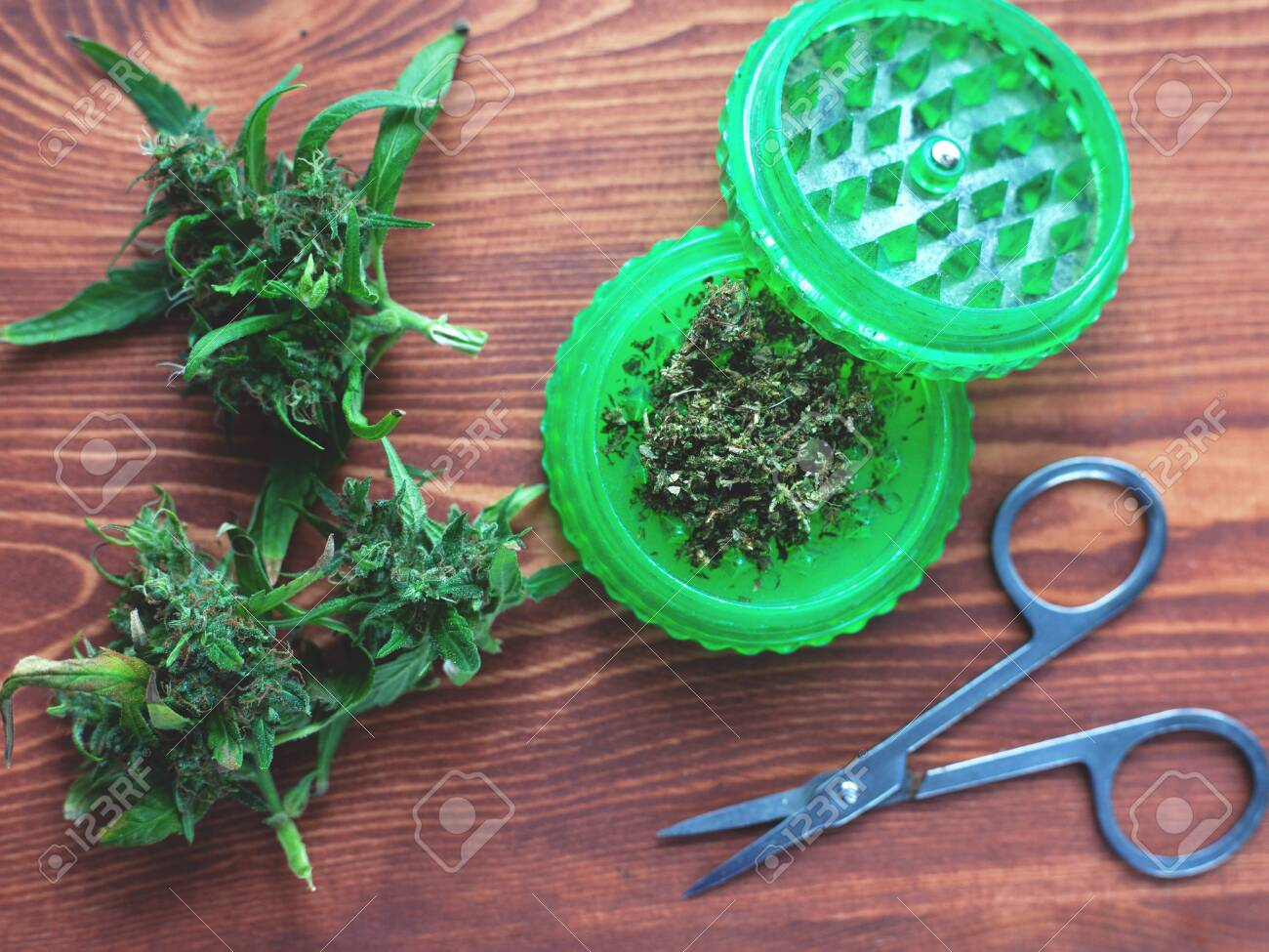 accessories for smoking marijuana on wooden background sativa