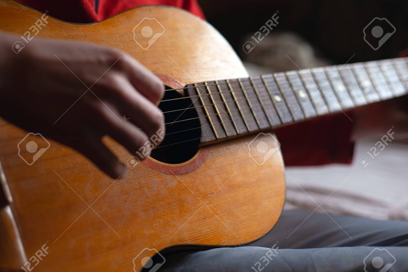 guitar strings. playing a musical instrument. guitar player. - 139583820