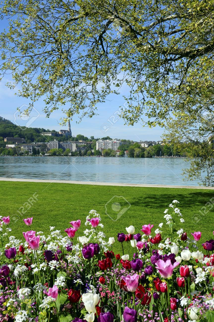 Annecy Lake Flowers And Annecy City On Spring Time France Stock