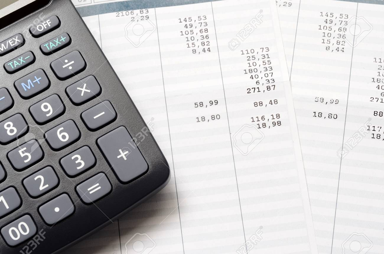 pay slip and calculator close up for payroll or salary background
