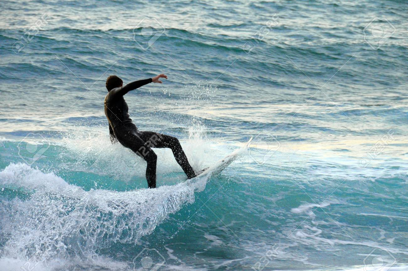 Surfer On A Wave In Black Suit Mediterranean Sea France