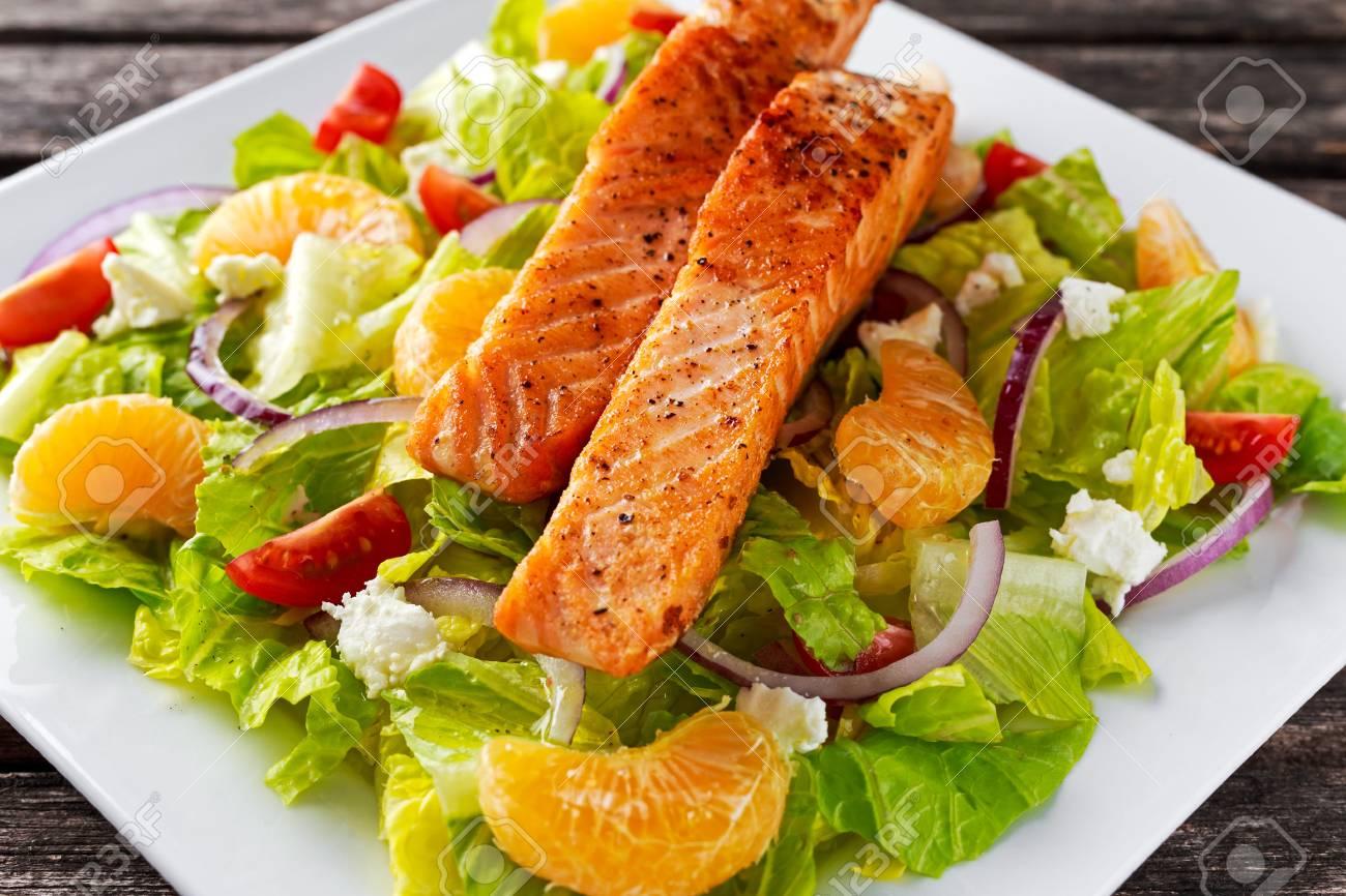 Fresh Orange Salmon salad with honey, tomatoes, onion, mandarin. healthy food concept - 63237957