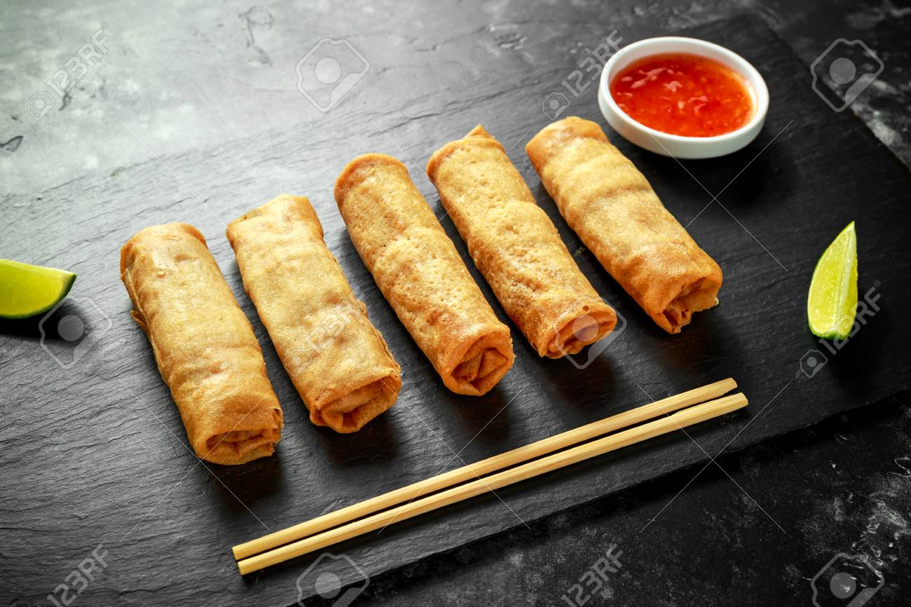 Chinese Vegetable Spring Rolls With Lime Wedges Sweet Chilli Stock Photo Picture And Royalty Free Image Image 97018141
