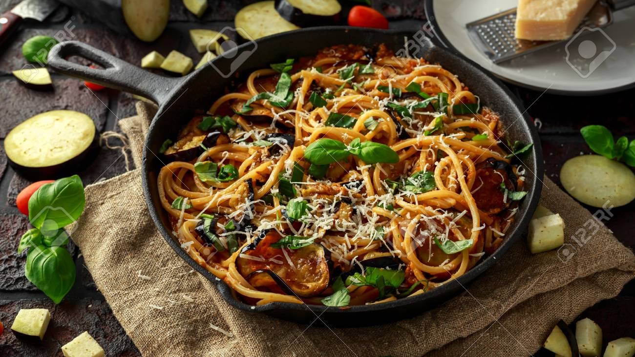Vegetarian italian pasta spaghetti alla norma with eggplant stock stock photo vegetarian italian pasta spaghetti alla norma with eggplant tomatoes basil and parmesan cheese in rustic skillet pan forumfinder Images