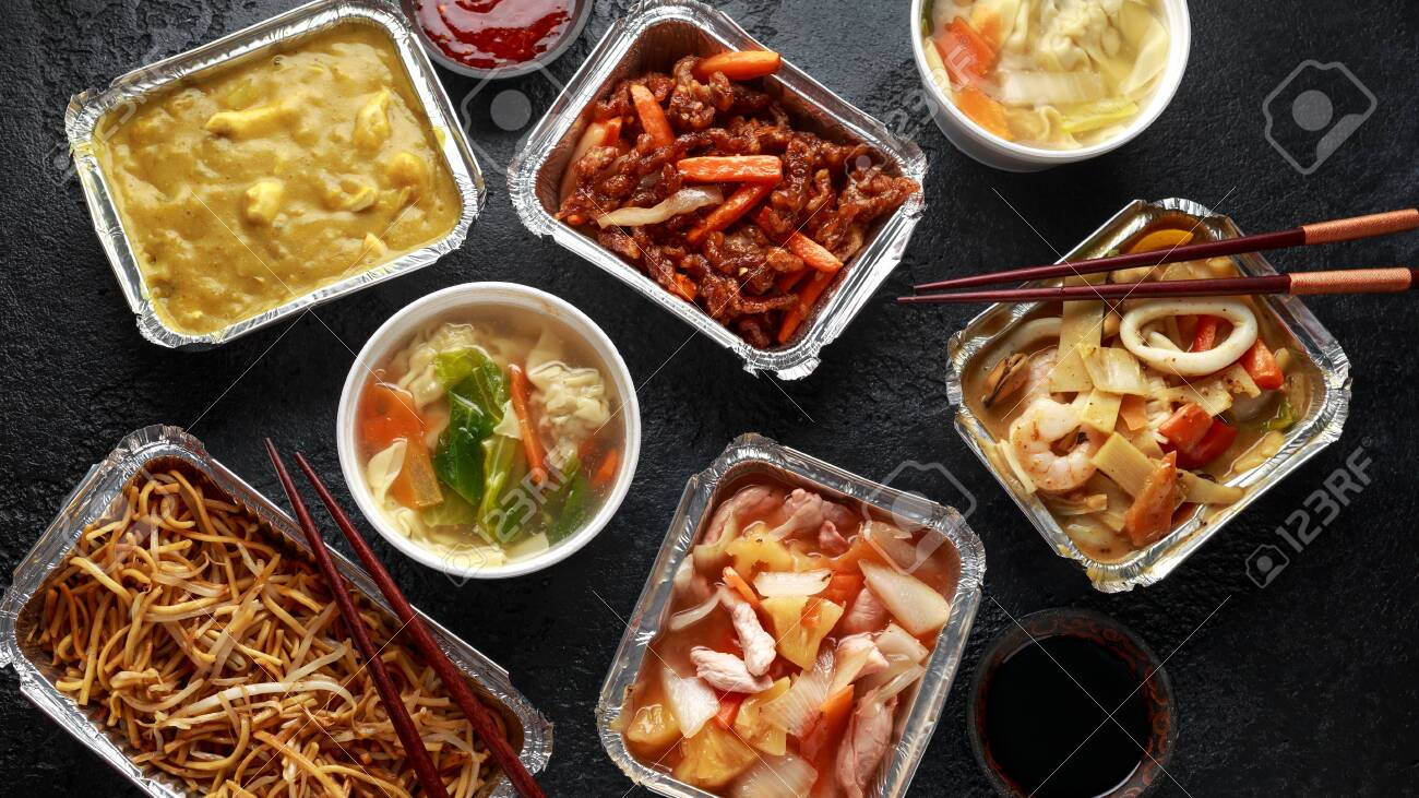 Chinese takeaway food. Pork Wonton dumpling soup, Crispy shredded beef, sweet and sour pineapple chicken, egg noodles with bean sprouts, curry. - 122065559