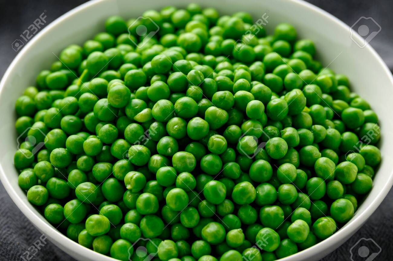 Green peas in white bowl. Healthy food - 144505687