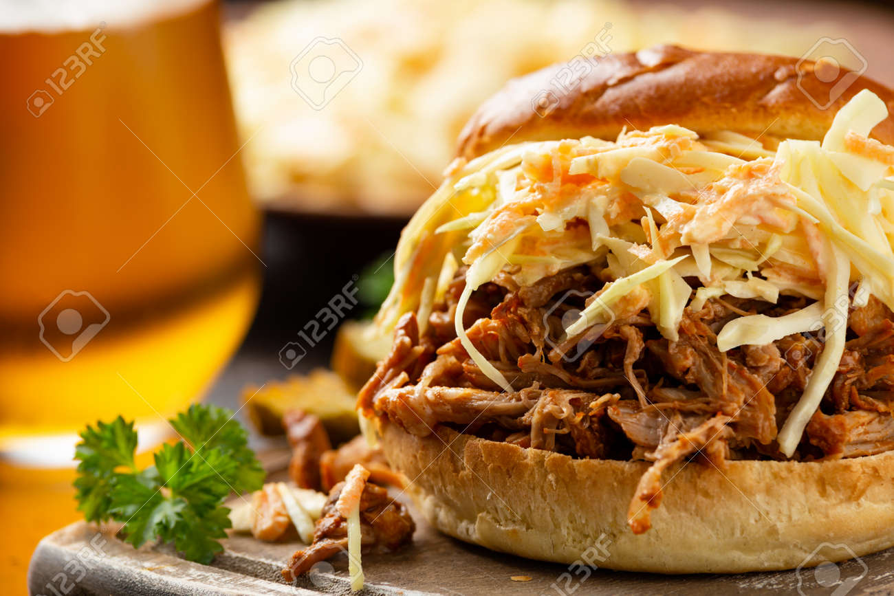 Homemade BBQ Pulled Pork burger with coleslaw, fries and beer - 166597434