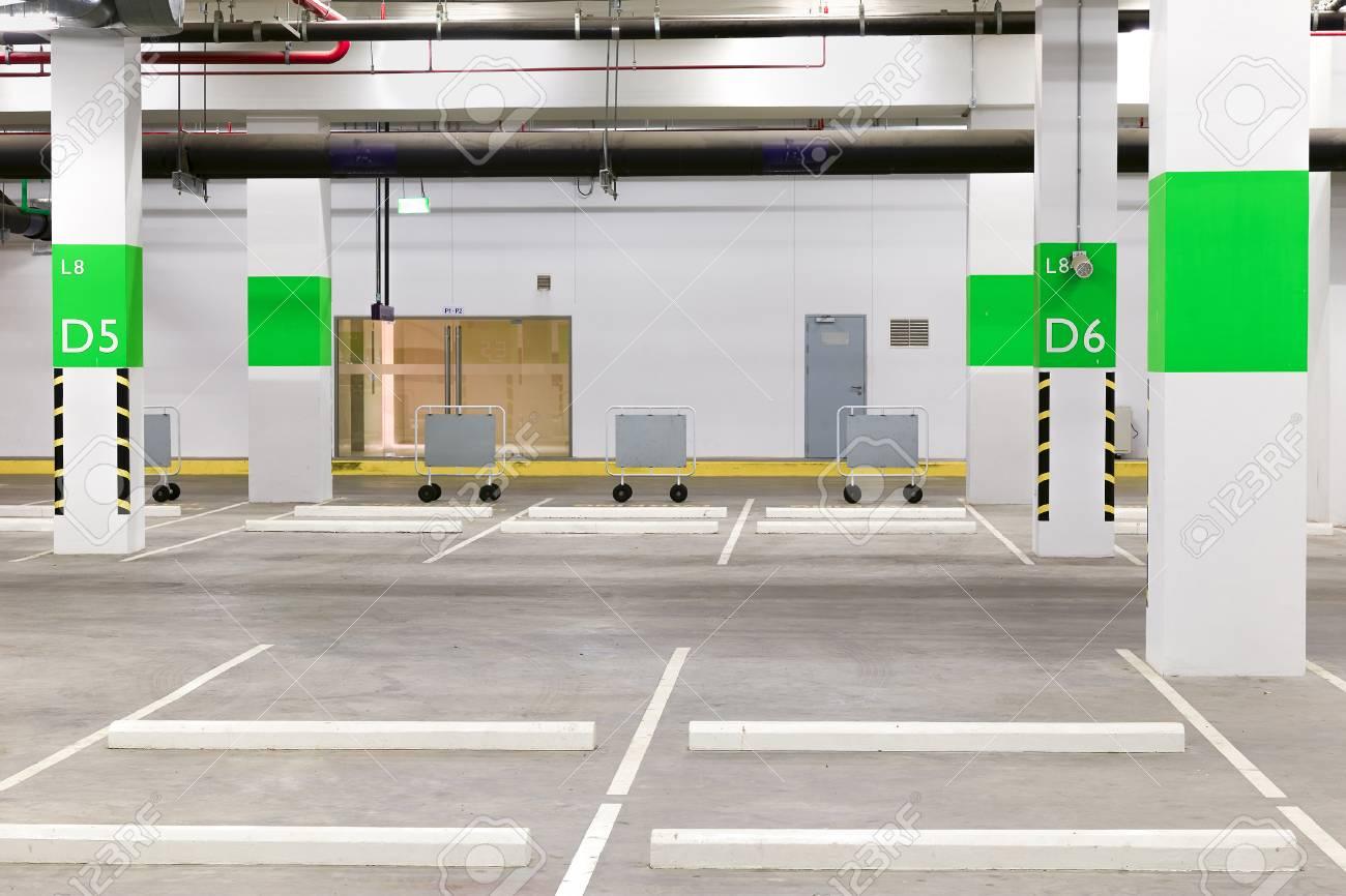 Parking Garage Interior, Neon Lights In Dark Industrial Building, Modern  Public Construction Stock Photo