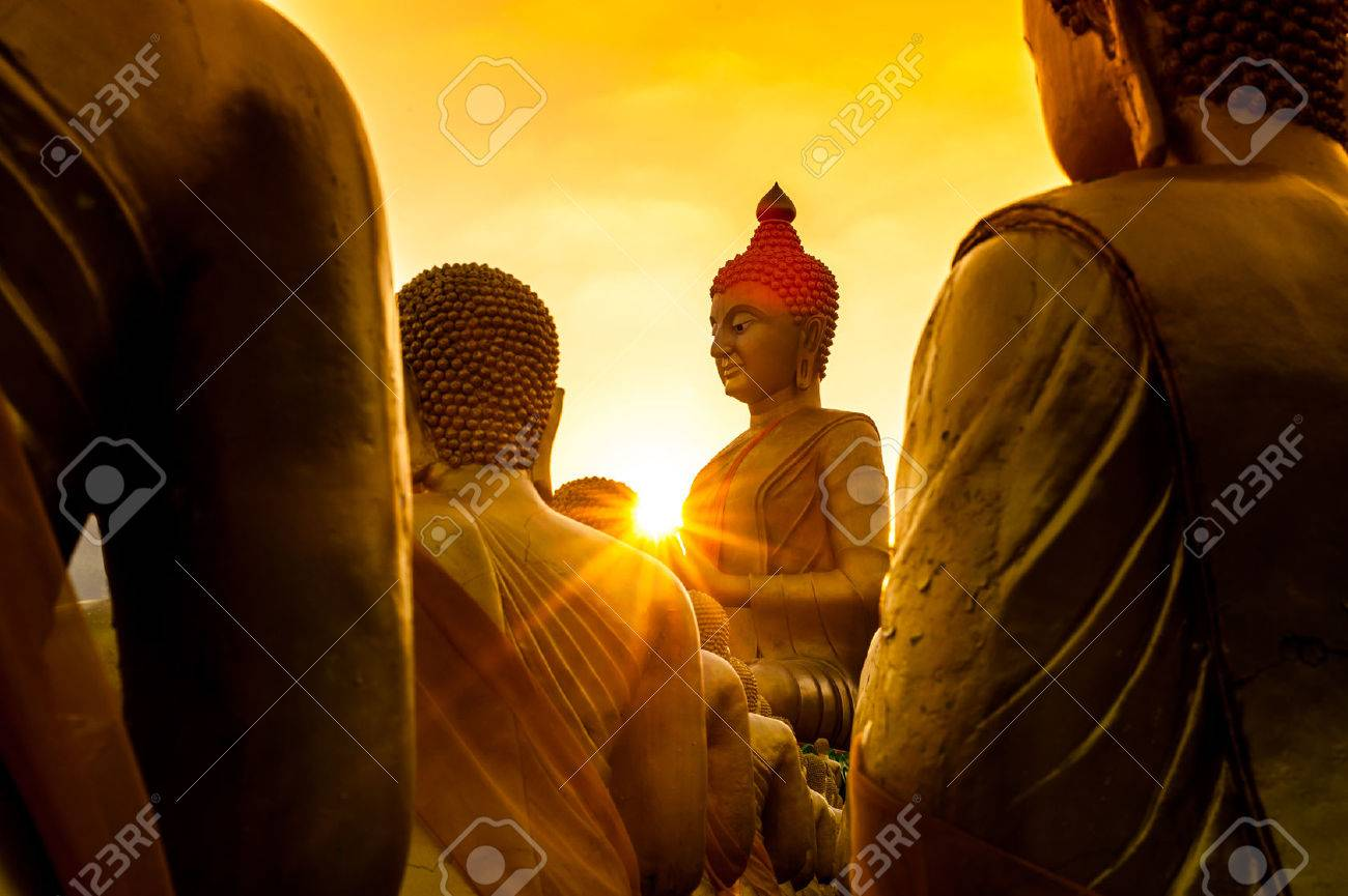 pay buddha in temple and beautiful sunset - 44872818