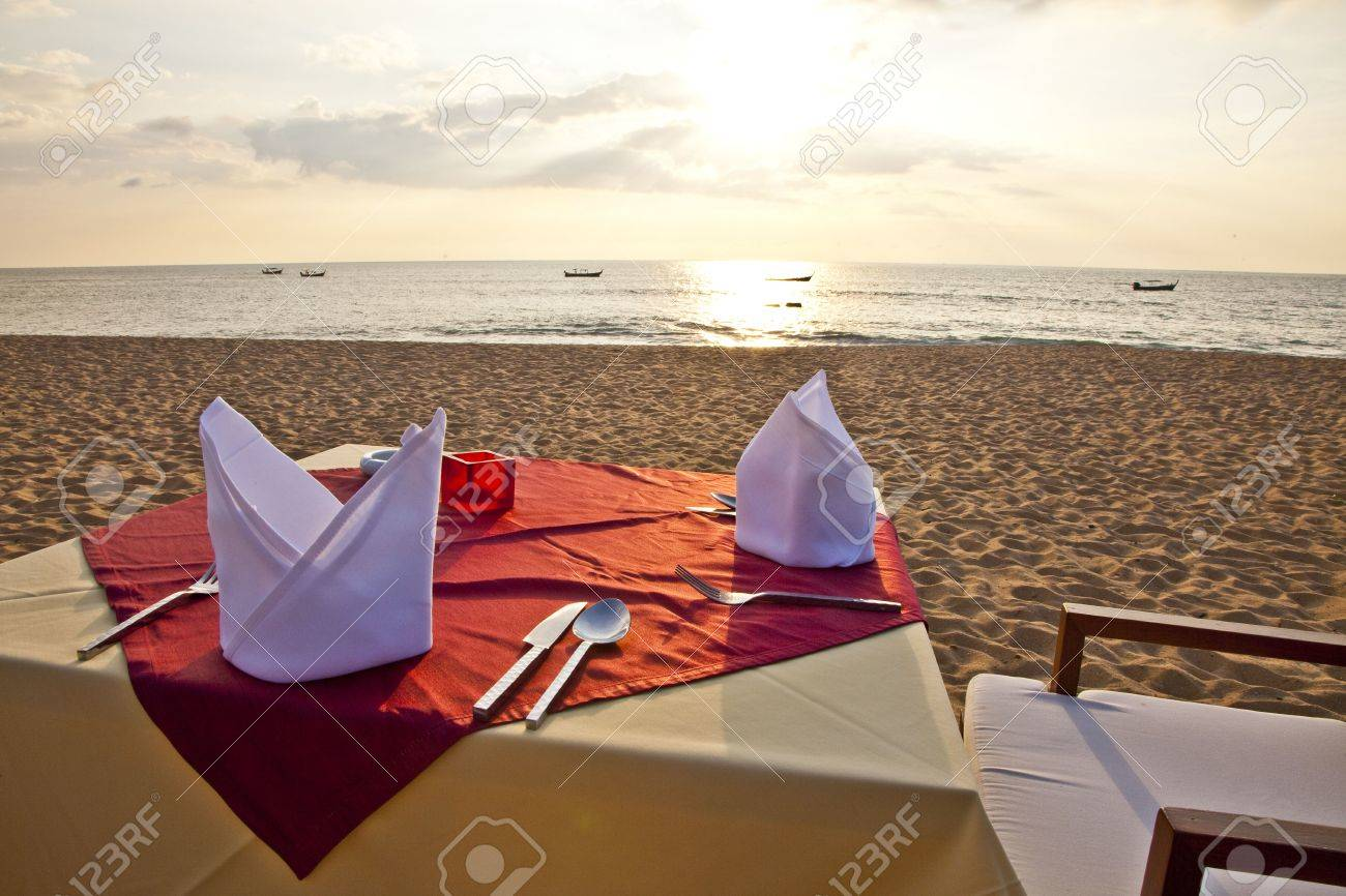 A Table is ready for Dinner at the Beach Stock Photo - 6599039