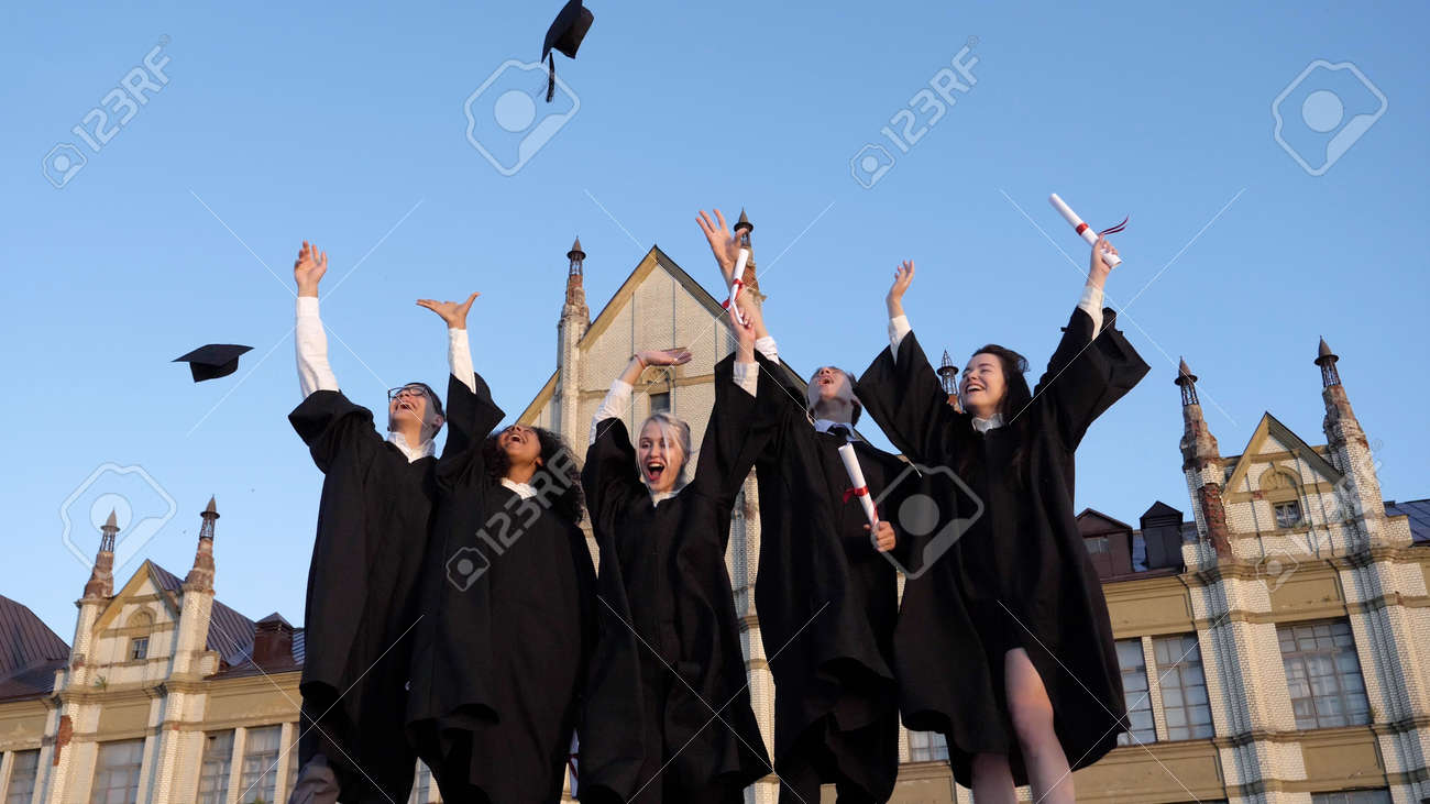 Group of diverse graduation students throwing their mortarboards - 158805580