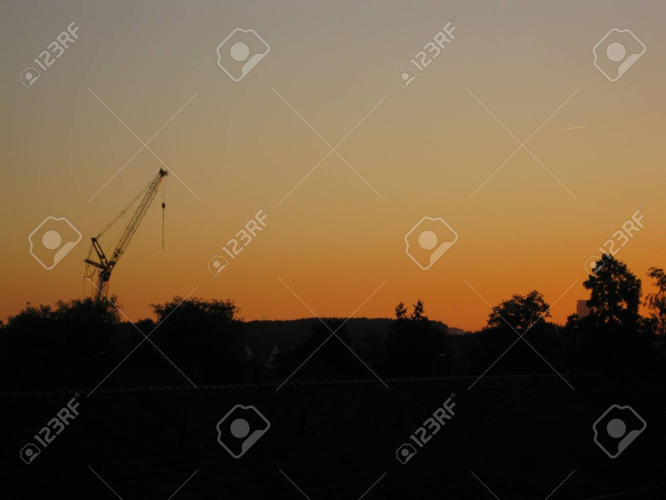 construction crane silhouette in sunset Stock Photo - 5105537