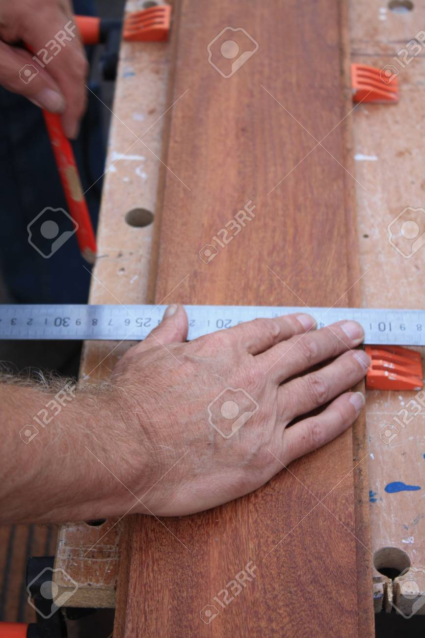 A Carpenter Getting Ready For Work, measuring wood Stock Photo - 5568277