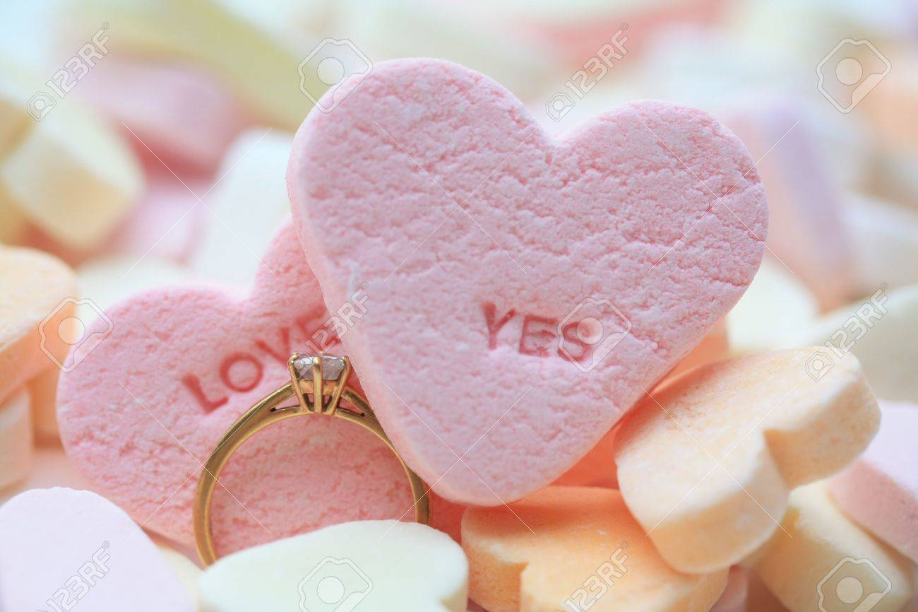 Solitaire Diamond Engagement Ring On Valentine Candy Heart With Love Yes  Text Stock Photo   6204216