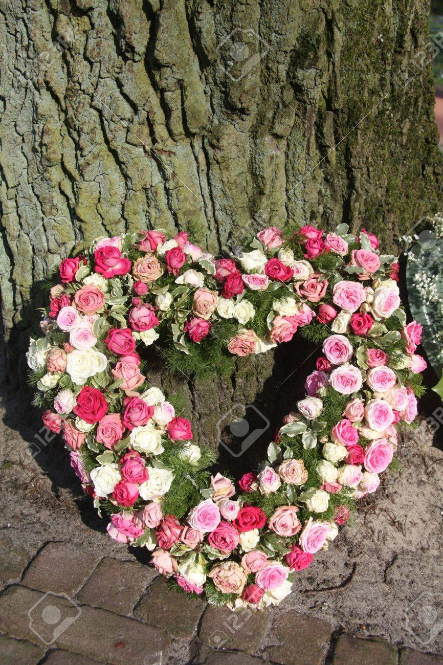 A sympathy flower arrangement, heart shaped and made of pink roses Stock Photo - 9257832