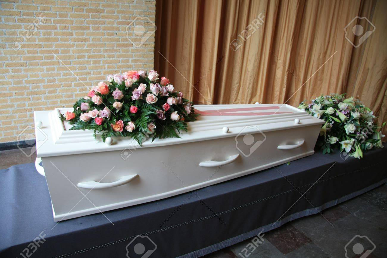 A Whtie Coffin With Pink Flowers At A Funeral Service Stock Photo