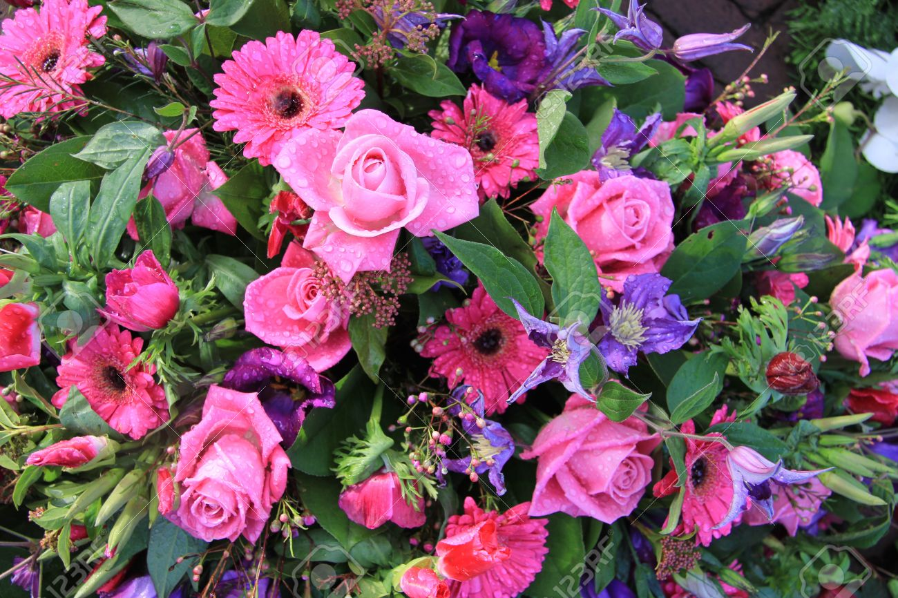 Floral Arrangement With Pink And Purple Flowers After A Rainshower