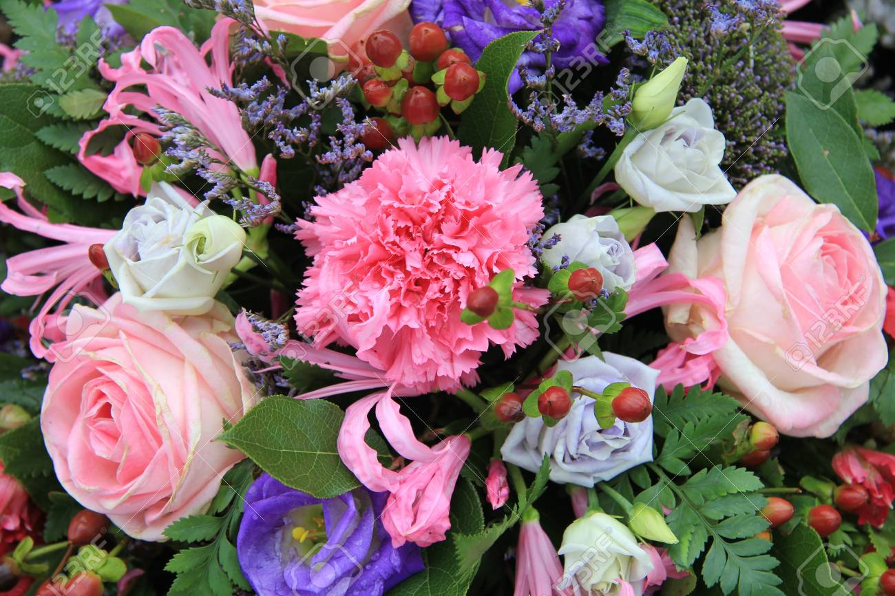 Pink And Blue Flowers In A Mixed Floral Arrangement Stock Photo