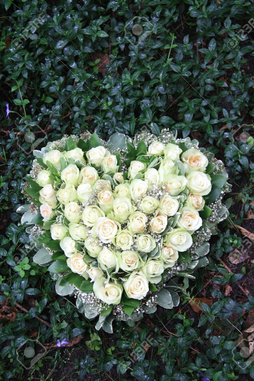Heart shaped sympathy flower arrangement with white roses - 12072908