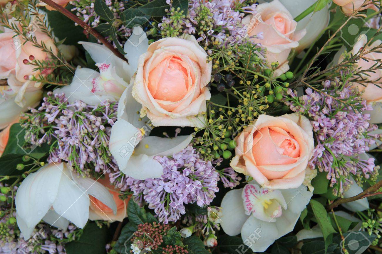 Soft orange roses common lilac and white orchids in a flower soft orange roses common lilac and white orchids in a flower arrangement stock photo dhlflorist Images