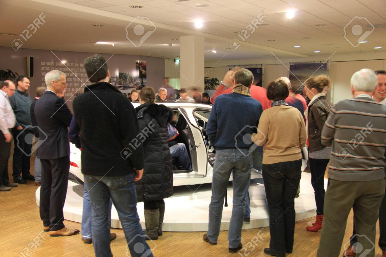 March 31st, Beesd the Netherlands Presentation of new Volvo V40, introduction of latest Volvo model, people in showroom Stock Photo - 13021615