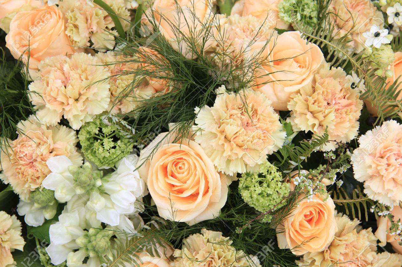 Carnations and roses in a pale orange shade, floral composition Stock Photo - 13198658