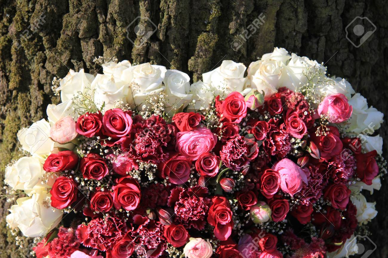 Floral Arrangement Of Pink And White Roses Near A Tree Stock Photo