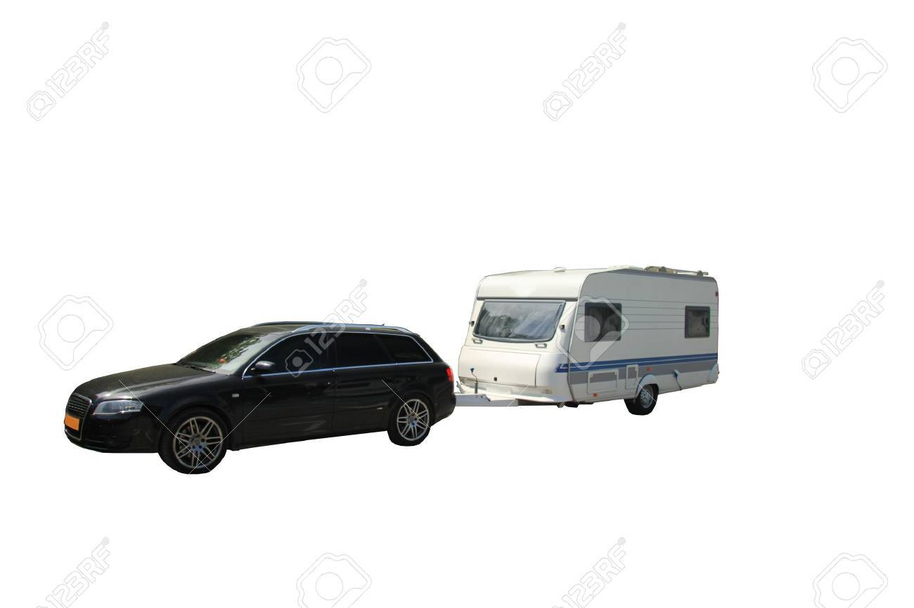 Middlesized car and caravan combination, ready to leave for vacation, isolated - 14015584