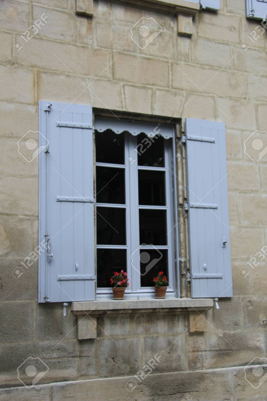 French Style Window With Painted Wooden Shutters