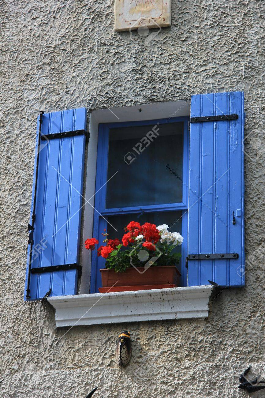 French Style Windows With Painted Wooden Shutters