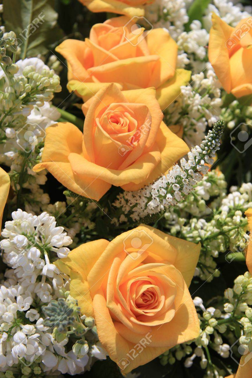 Wedding Flower Arrangement With Yellow Roses And White Common